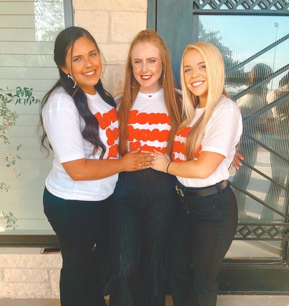 Three women standing together during Panhellenic recruitment