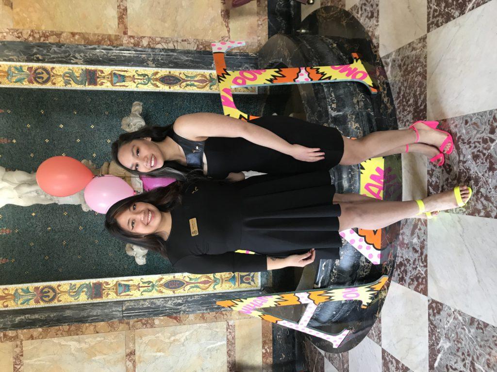 Two women wearing black dresses during sorority recruitment.